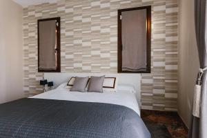 Una cama o camas en una habitación de ARDO-OH! LABASTIDA