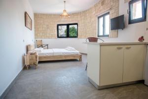 Ein Bett oder Betten in einem Zimmer der Unterkunft PanMari