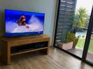 A television and/or entertainment center at Troon 36 Moonah Links