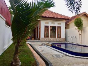 The swimming pool at or near Sunbeam Villa