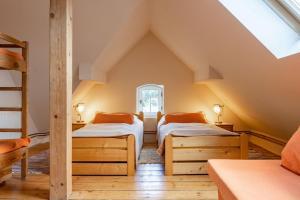 Postel nebo postele na pokoji v ubytování Vila Josefina Jizerské hory
