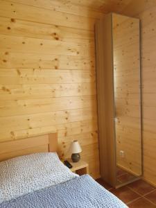 Postel nebo postele na pokoji v ubytování Sport-hotel Šibeniční vrch