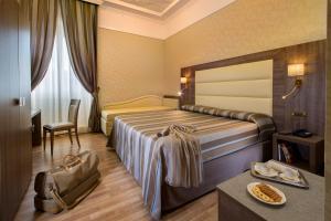 Cama o camas de una habitación en Hotel Ranieri