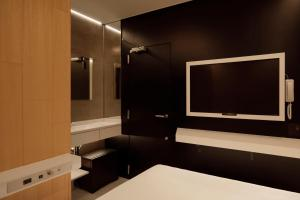 A television and/or entertainment center at hotel min.