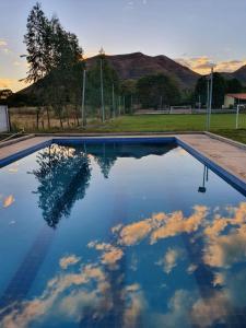 The swimming pool at or near Pousada do Rio Corrente