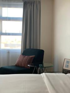 A bed or beds in a room at Quest Napier Serviced Apartments
