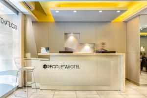 O saguão ou recepção de Up Recoleta Hotel