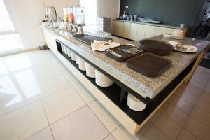 A kitchen or kitchenette at Adya Hotel Chenang