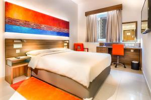A bed or beds in a room at Citymax Hotel Al Barsha at the Mall
