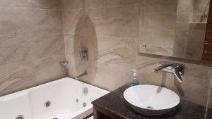 A bathroom at The Celebrations by HNH