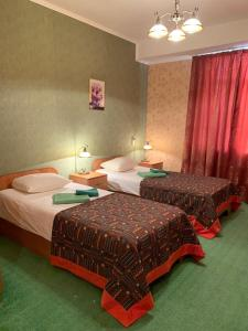 A bed or beds in a room at Hotel Dom Uchenykh