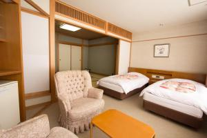 A bed or beds in a room at Yuzawa Grand Hotel