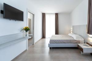 Letto o letti in una camera di Vasto Aparthotel