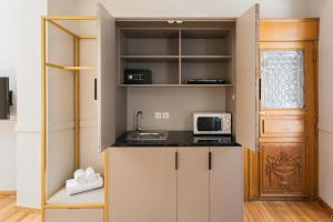 A kitchen or kitchenette at Step One | Luxury Suites right in the heart of Acropolis next to metro station