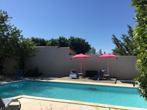 The swimming pool at or near Le Mas des Platanes