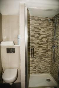 Ванная комната в Hotel Paris Bruxelles