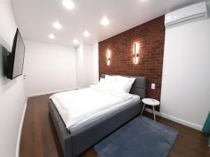 Кровать или кровати в номере Apartment на Ленинском проспекте 29, Колибри в Центре
