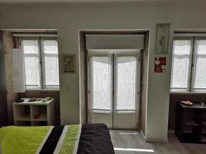 A bed or beds in a room at Coração de Viana