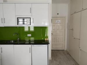 A kitchen or kitchenette at Coração de Viana