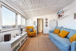 Zona de estar de AL - Alojamento Local Pension Bicuar