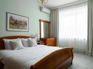 A bed or beds in a room at Oktyabrskaya Hotel