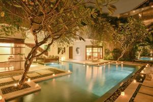 The swimming pool at or near Nyaman Villas