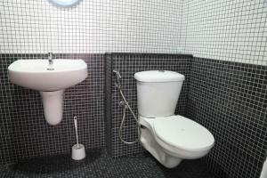 A bathroom at Indregal Infopark Kakkanad Corporate Suit Rooms