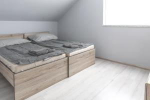A bed or beds in a room at 4E KLIMA