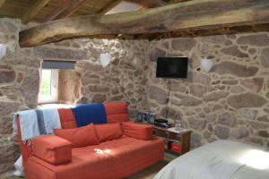 A seating area at Peneda Mountain Cottage