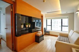 A television and/or entertainment center at Mia Casa Hotel