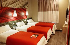 A bed or beds in a room at Ibis Nizhniy Novgorod