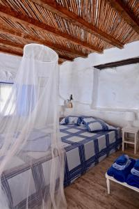A bed or beds in a room at villa Clio Serifos