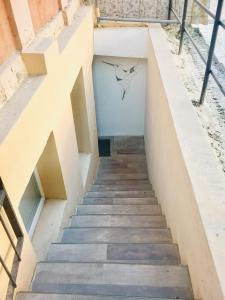 A balcony or terrace at Small Cozy apartment at the center 1