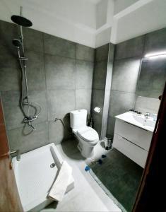 Salle de bains dans l'établissement Thomas Art Hotel