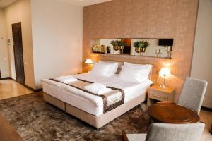 Кровать или кровати в номере Oasis Residence