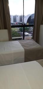 A bed or beds in a room at Tamara-Garvey Park Hotel