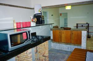 A kitchen or kitchenette at Chalés KiteSurf Brasil