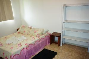 A bed or beds in a room at Chalés KiteSurf Brasil