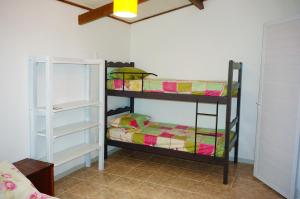 A bunk bed or bunk beds in a room at Chalés KiteSurf Brasil