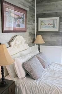 A bed or beds in a room at The Roost