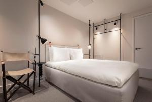 A bed or beds in a room at Blique by Nobis, Stockholm, a Member of Design Hotels™