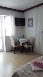 Телевизор и/или развлекательный центр в Apartments Marina