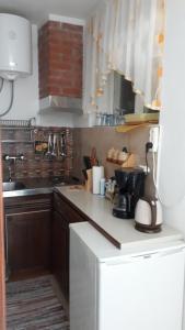 Кухня или мини-кухня в Apartments Marina