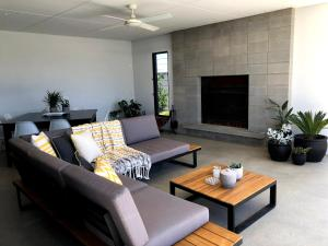 A seating area at The Sinatra Holiday House - Couples Retreat