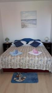 Кровать или кровати в номере Apartments Marina