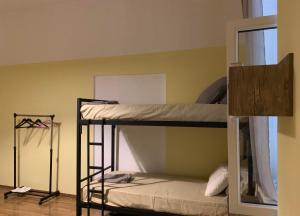 A bunk bed or bunk beds in a room at Bibliotek