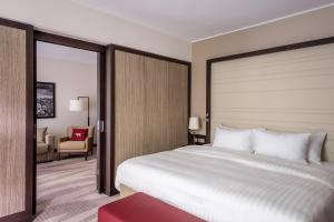 A bed or beds in a room at Munich Airport Marriott Hotel
