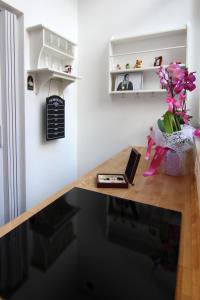 TV o dispositivi per l'intrattenimento presso Rosemary Charming Rooms