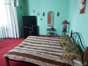 A bed or beds in a room at House for rent