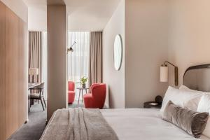 A bed or beds in a room at The Stratford Hotel London
